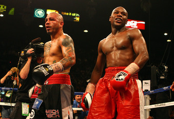 LAS VEGAS, NV - MAY 05:  Miguel Cotto and Floyd Mayweather Jr. react after the end of the 12th round after their WBA super welterweight title fight at the MGM Grand Garden Arena on May 5, 2012 in Las Vegas, Nevada. Mayweather Jr. defeated Cotto by unanimo