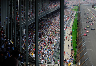 INDIANAPOLIS, IN - MAY 29:  Cars race down the frontstretch during the IZOD IndyCar Series Indianapolis 500 Mile Race at Indianapolis Motor Speedway on May 29, 2011 in Indianapolis, Indiana.  (Photo by Robert Laberge/Getty Images)