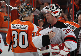 PHILADELPHIA, PA - MAY 08: Ilya Bryzgalov #30 of the Philadelphia Flyers and Martin Brodeur #30 of the New Jersey Devils shake hands following the Devils victory over the Philadelphia Flyers in Game Five of the Eastern Conference Semifinals during the 201