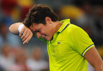 MADRID, SPAIN - MAY 09:  Milos Raonic of Canada feels the heat during his 3rd round defeat to Roger Federer of Switzerland in the Mutua Madrilena Madrid Open at the Caja Magica on May 9, 2012 in Madrid, Spain.  (Photo by Mike Hewitt/Getty Images)