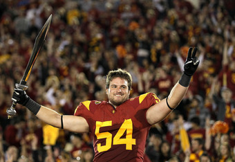 LOS ANGELES, CA - NOVEMBER 26:  Linebacker Chris Galippo #54 of the USC Trojans conducts the band after the game with the UCLA Bruins at the Los Angeles Memorial Coliseum on November 26, 2011 in Los Angeles, California. USC won 50-0.  (Photo by Stephen Du