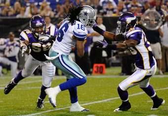 MINNEAPOLIS, MN - AUGUST 27: Jesse Holley #16 of the Dallas Cowboys carries the ball as Byron Isom #58 and Mistral Raymond #30 of the Minnesota Vikings look to tackle on August 27, 2011 at Hubert H. Humphrey Metrodome in Minneapolis, Minnesota. The Cowboy