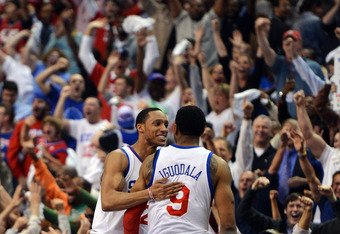 Evan Turner embraces Andre Iguodala after the final buzzer