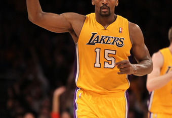 LOS ANGELES, CA - FEBRUARY 14:  Metta World Peace #15 of  the Los Angeles Lakers celebrates during the game with the Atlanta Hawks at Staples Center on February 14, 2012 in Los Angeles, California.  The Lakers won 86-78.  NOTE TO USER: User expressly ackn