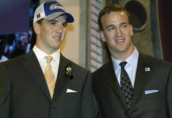 NEW YORK CITY - APRIL 24:  Quarterback Eli Manning (Mississippi) stands next to his older brother QB Peyton Manning of the Indianapolis Colts after Eli was selected first overall by the San Diego Chargers at the 2004 NFL Draft on April 24, 2004 at Madison
