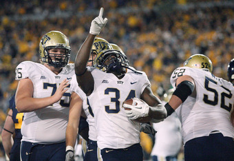 MORGANTOWN, WV - NOVEMBER 25:  Isaac Bennett #34 of the University of Pittsburgh Panthers celebrates after running in for a touchdown in the first half against the West Virginia Mountaineers during the 2011 Backyard Brawl on November 25, 2011 at Mountaine