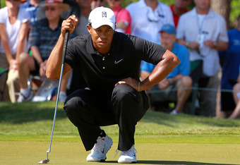 PONTE VEDRA BEACH, FL - MAY 11:  Tiger Woods of the United States lines up his putt on the eighth green during the second round of THE PLAYERS Championship held at THE PLAYERS Stadium course at TPC Sawgrass on May 11, 2012 in Ponte Vedra Beach, Florida.