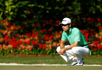 PONTE VEDRA BEACH, FL - MAY 11: Kevin Na of the United States lines up a putt on the 14th hole during the second round of THE PLAYERS Championship held at THE PLAYERS Stadium course at TPC Sawgrass on May 11, 2012 in Ponte Vedra Beach, Florida.  (Photo by