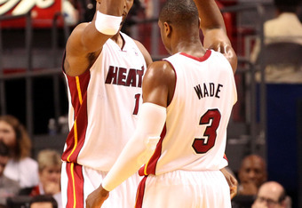 MIAMI, FL - MAY 09:  Forward Chris Bosh #1 (L) and Guard Dwyane Wade #3 of the Miami Heat celebrate against the against the New York Knicks in Game Five of the Eastern Conference Quarterfinals in the 2012 NBA Playoffs  on May 9, 2012 at the American Airin
