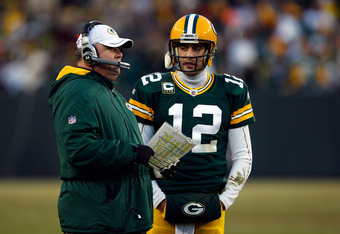 GREEN BAY, WI - JANUARY 15:  Head coach Mike McCarthy of the Green Bay Packers talks with  Aaron Rodgers #12 on the sidelines against the New York Giants during their NFC Divisional playoff game at Lambeau Field on January 15, 2012 in Green Bay, Wisconsin