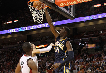 MIAMI, FL - FEBRUARY 08: Roy Hibbert #55 of the Indiana Pacers shoots over Chris Bosh #1 of the Miami Heat during a game at American Airlines Arena on February 8, 2011 in Miami, Florida. NOTE TO USER: User expressly acknowledges and agrees that, by downlo