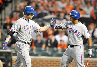 Josh Hamilton is greeted by teammate Adrian Beltre after his home run at Camden Yards.