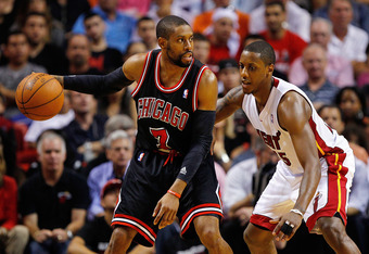 MIAMI, FL - APRIL 19: C.J. Watson #7 of the Chicago Bulls posts up Mario Chalmers #15 of the Miami Heat during a game at American Airlines Arena on April 19, 2012 in Miami, Florida. NOTE TO USER: User expressly acknowledges and agrees that, by downloading