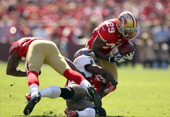 SAN FRANCISCO, CA - OCTOBER 09:   Chris Culliver #29 of the San Francisco 49ers intercepts a pass during their game against the Tampa Bay Buccaneers at Candlestick Park on October 9, 2011 in San Francisco, California.  (Photo by Ezra Shaw/Getty Images)