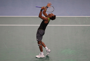 PARIS - NOVEMBER 13:  Gael Monfils of France celebrates match point in his 7-6,6-7,7-6 semi-final victory against Roger Federer of Switzerland during Day Seven of the ATP Masters Series Paris at the Palais Omnisports  on November 13, 2010 in Paris, France