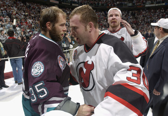 EAST RUTHERFORD, NJ - JUNE 9:  Martin Brodeur #30 of the New Jersey Devils and Jean-Sebastien Giguere #35 the Mighty Ducks of Anaheim shake hands after game seven of the 2003 Stanley Cup Finals at Continental Airlines Arena on June 9, 2003 in East Rutherf