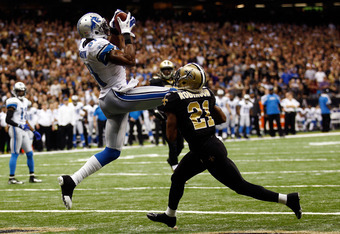 NEW ORLEANS, LA - JANUARY 07:   Calvin Johnson #81 of the Detroit Lions makesa touchdown catch against  Patrick Robinson #21 of the New Orleans Saints during their 2012 NFC Wild Card Playoff game at Mercedes-Benz Superdome on January 7, 2012 in New Orlean
