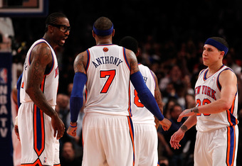 NEW YORK, NY - MAY 06:  (L-R) Amare Stoudemire #1, Carmelo Anthony #7 and Mike Bibby #20 of the New York Knicks talk on court in the second half against the Miami Heat in Game Four of the Eastern Conference Quarterfinals in the 2012 NBA Playoffs on May 6,