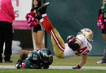 PHILADELPHIA, PA - OCTOBER 02:  Nate Allen #29 of the Philadelphia Eagles tackles  Bruce Miller #49 of the San Francisco 49ers during the second half at Lincoln Financial Field on October 2, 2011 in Philadelphia, Pennsylvania.  The 49ers defeated the Eagl