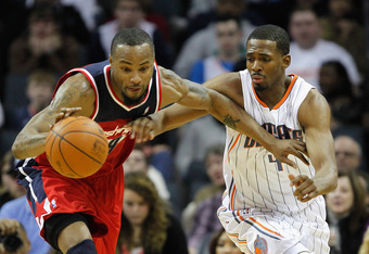 CHARLOTTE, NC - JANUARY 28:  Rashard Lewis #9 of the Washington Wizards and Derrick Brown #4 of the Charlotte Bobcats battle for a ball during their game at Time Warner Cable Arena on January 28, 2012 in Charlotte, North Carolina. NOTE TO USER: User expre
