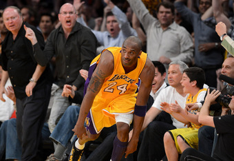 LOS ANGELES, CA - MAY 12:  Kobe Bryant #24 of the Los Angeles Lakers falls into the front row after making a basket in the fourth quarter while taking on the Denver Nuggets in Game Seven of the Western Conference Quarterfinals in the 2012 NBA Playoffs on