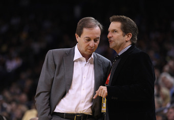 OAKLAND, CA - MARCH 27:  Golden State Warriors co-owners Joe Lacob (L) and Peter Guber talk during the Warriors game against the Los Angeles Lakers at Oracle Arena on March 27, 2012 in Oakland, California. NOTE TO USER: User expressly acknowledges and agr