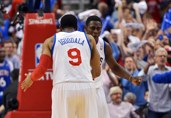 PHILADELPHIA, PA - MAY 06: Andre Iguodala #9 and Jrue Holiday #11 of the Philadelphia 76ers celebrate in the fourth quarter after a three point shot by Holiday in Game Four of the Eastern Conference Quarterfinals in the 2012 NBA Playoffs at the Wells Farg
