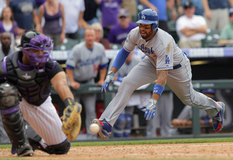 DENVER, CO - MAY 02:  Matt Kemp #27 of the Los Angeles Dodgers slides home to score behind catcher Wilin Rosario #20 of the Colorado Rockies on a double by Dee Gordon #9 of the Los Angeles Dodgers to tie the score 5-5 in the ninth inning at Coors Field on