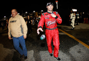 Kevin Harvick storms through the garage area after a fight with Kyle Busch