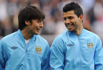 NEWCASTLE UPON TYNE, ENGLAND - MAY 06: David Silva and Sergio Aguero of Manchester City share a joke before the Barclays Premier League match between Newcastle United and Manchester City at the Sports Direct Arena on May 6, 2012 in Newcastle upon Tyne, En