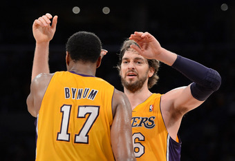 LOS ANGELES, CA - MAY 12:  (R-L) Pau Gasol #16 hugs teammate Andrew Bynum #17 of the Los Angeles Lakers in the fourth quarter while taking on the Denver Nuggets in Game Seven of the Western Conference Quarterfinals in the 2012 NBA Playoffs on May 12, 2012