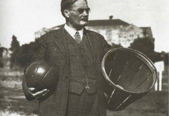 James Naimisth hold a soccer ball and a peach basket, the first type of basket used. Courtesy of businessinsider.com