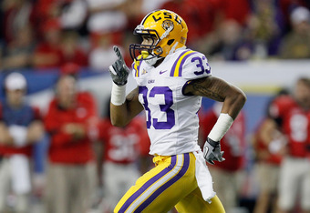 ATLANTA, GA - DECEMBER 03:   Odell Beckham Jr. #33 of the LSU Tigers celebrates after a play on he thought scored a touchdown but the play was called back in the third quarter against the Georgia Bulldogs during the 2011 SEC Conference Championship at  Ge