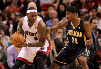 MIAMI, FL - FEBRUARY 08:  LeBron James #6 of the Miami Heat posts up Paul George #24 of the Indiana Pacers during a game at American Airlines Arena on February 8, 2011 in Miami, Florida. NOTE TO USER: User expressly acknowledges and agrees that, by downlo