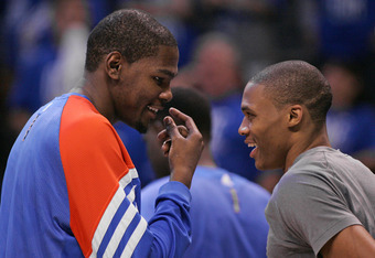 OKLAHOMA CITY, OK - MAY 14:  Kevin Durant #35 and Russell Westbrook #0 of the Oklahoma City Thunder talk late in the second half against the Los Angeles Lakers in Game One of the Western Conference Semifinals in the 2012 NBA Playoffs on May 14, 2012 at th