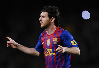 BARCELONA, SPAIN - MAY 05:  Lionel Messi of FC Barcelona celebrates after scoring the opening goal during the La Liga match between FC Barcelona and RCD Espanyol at Camp Nou on May 5, 2012 in Barcelona, Spain.  (Photo by David Ramos/Getty Images)