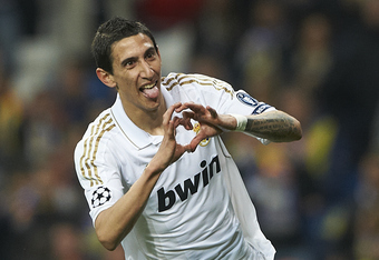 MADRID, SPAIN - APRIL 04:  Angel Di Maria of Real Madrid celebrates after scoring during the UEFA Champions League quarter-final second leg match between Real Madrid and APOEL FC at Bernabeu on April 4, 2012 in Madrid, Spain.  (Photo by Manuel Queimadelos