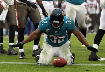 JACKSONVILLE, FL - DECEMBER 11:  Maurice Jones-Drew #32 of the Jacksonville Jaguars gestures over the ball follwing a touchdown during the game against the Tampa Bay Buccaneers at EverBank Field on December 11, 2011 in Jacksonville, Florida.  (Photo by Sa
