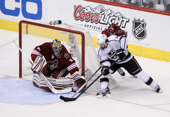 GLENDALE, AZ - MAY 15:  Justin Williams #14 of the Los Angeles Kings tries for the wrap-around as goaltender Mike Smith #41 of the Phoenix Coyotes defends his net in the second period of Game Two of the Western Conference Final during the 2012 NHL Stanley