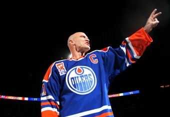 EDMONTON, CANADA - FEBRUARY 27:  Former Edmonton Oilers great Mark Messier #11 salutes his fans as he takes a final skate around the ice during a ceremony to raise his #11 banner to the rafters of Rexall Place prior to the Oilers game against the Phoenix