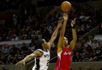 SAN ANTONIO, TX - MAY 15:  Caron Butler #5 of the Los Angeles Clippers shoots over Kawhi Leonard #2 of the San Antonio Spurs in Game One of the Western Conference Semifinals in the 2012 NBA Playoffs at AT&T Center on May 15, 2012 in San Antonio, Texas. NO