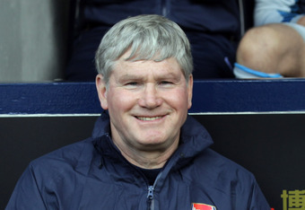 WEST BROMWICH, ENGLAND - MAY 13:  13:  Pat Rice, Arsenal assistant manager seated during the Barclays Premier League match between West Bromwich Albion and Arsenal at The Hawthorns on May 13, 2012 in West Bromwich, England.  (Photo by Ross Kinnaird/Getty