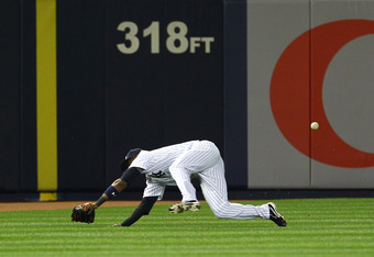 NEW YORK, NY - MAY 01:  Eduardo Nunez #26 of the New York Yankees makes an error off of a ball hit by Nick Johnson #36 of the Baltimore Orioles during their game on May 1, 2012 at Yankee Stadium in the Bronx borough of New York City.  (Photo by Al Bello/G