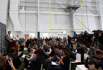 FLORHAM PARK, NJ - MARCH 26:  Quarterback Tim Tebow addresses the media as he is introduced as a New York Jet at the Atlantic Health Jets Training Center on March 26, 2012 in Florham Park, New Jersey. Tebow, traded from the Denver Broncos last week, will