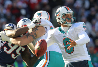 FOXBORO, MA - DECEMBER 24:    Matt Moore #8 of the Miami Dolphins throws during a game against the New England Patriots in the second quarter at Gillette Stadium on December 24, 2011 in Foxboro, Massachusetts. (Photo by Jim Rogash/Getty Images)