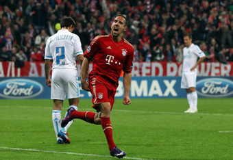 MUNICH, GERMANY - APRIL 03:  Franck Ribery of Muenchen celebrates his team's opening goal during the UEFA Champions League quarter-final second leg match at Allianz Arena on April 3, 2012 in Munich, Germany.  (Photo by Martin Rose/Bongarts/Getty Images)
