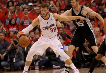 Blake Griffin #32 of the Los Angeles Clippers catches a pass in front of Matt Bonner #15 of the San Antonio Spurs in Game Three of the Western Conference Semifinals in the 2012 NBA Playoffs on May 19, 2011 at Staples Center in Los Angeles, California.  NO