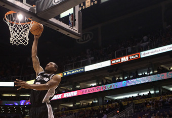 PHOENIX, AZ - APRIL 25:  Kawhi Leonard #2 of the San Antonio Spurs lays up a shot against the Phoenix Suns during the NBA game at US Airways Center on April 25, 2012 in Phoenix, Arizona.  NOTE TO USER: User expressly acknowledges and agrees that, by downl