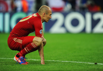 MUNICH, GERMANY - MAY 19:  Arjen Robben of Bayern Muenchen looks dejected after their defeat in the UEFA Champions League Final between FC Bayern Muenchen and Chelsea at the Fussball Arena München on May 19, 2012 in Munich, Germany.  (Photo by Mike Hewitt