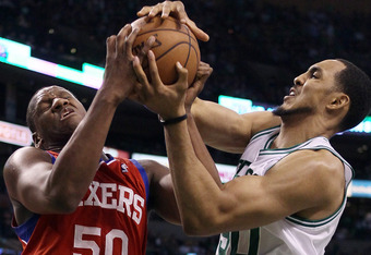 BOSTON, MA - MAY 14: Lavoy Allen #50 of the Philadelphia 76ers and Ryan Hollins #50 of the Boston Celtics fight for the ball in Game Two of the Eastern Conference Semifinals in the 2012 NBA Playoffs on May 14, 2012 at TD Garden in Boston, Massachusetts. N